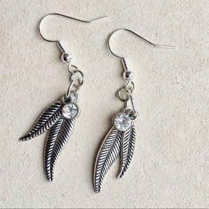 Feather design earrings with white/ clear stone
